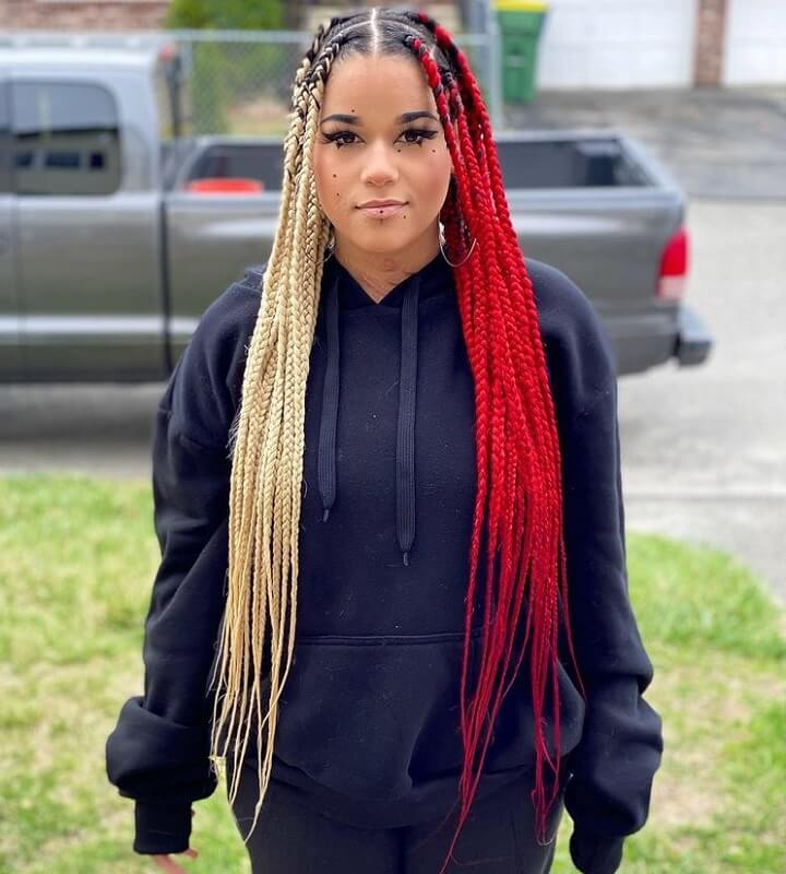 girl with red and blonde box braids