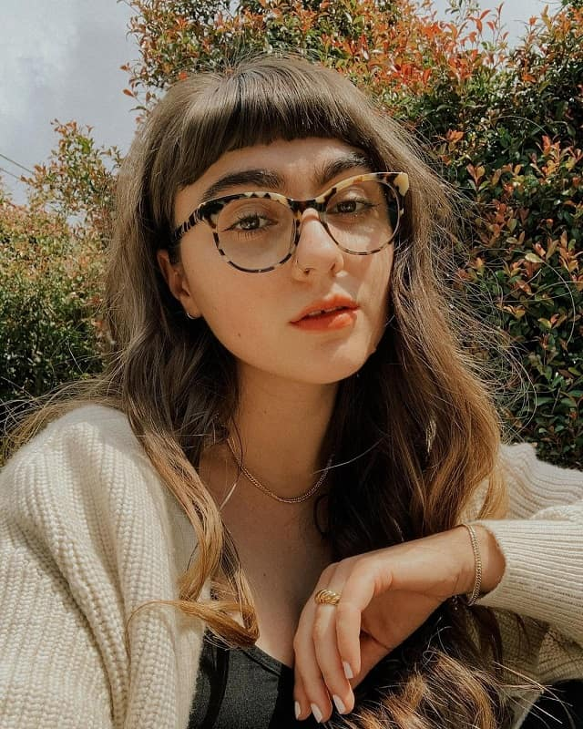 bangs for heart shaped face with glasses